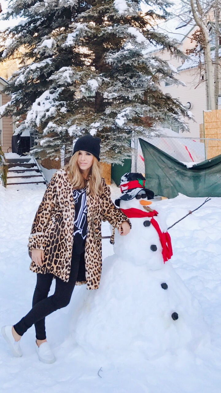 Kelley Fertitta leaning on a snowman