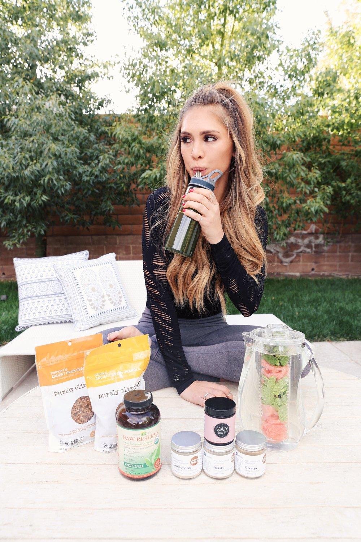 Kelley Fertitta sipping a water bottle during a yoga break
