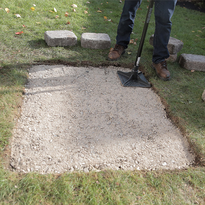 how-to-build-a-custom-fire-pit-tamp-paver-base.jpg