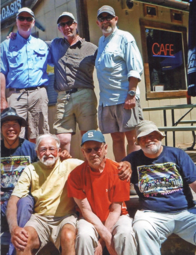 "Leon Speroff (in yellow shirt) with ""The Boys"":    Top row, left to right: Phil Patton, Marc Fritz, Lee Hickok    Bottom row, left to right: David Lee, Leon Speroff, Don Wolf, Peter Staples"