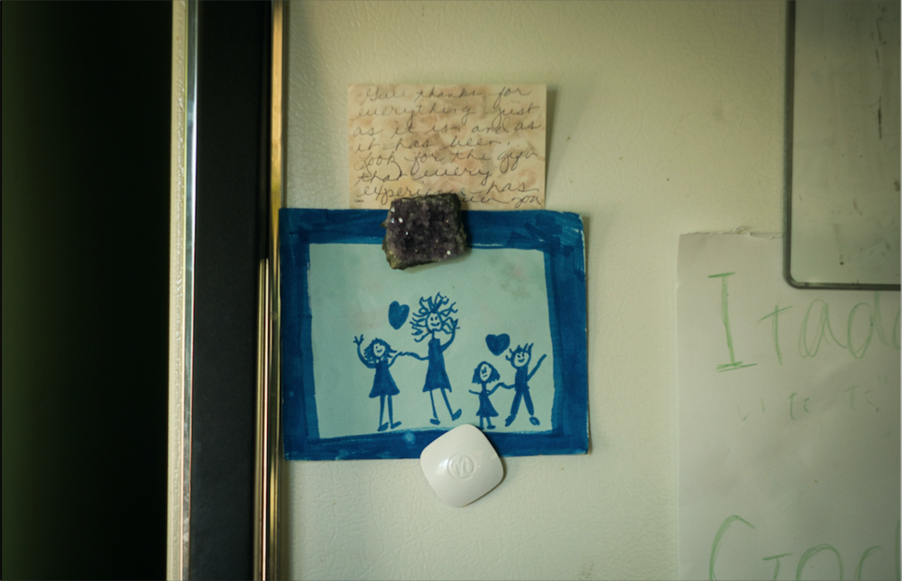 "A note reading, ""Give thanks for everything just as it is and as it has been. Look for the gift that every experience has given you,"" sits above a child's drawing. There is no dad in the picture, a small and sweet detail of Abi Barella's experiences as a single mom. From left to right, it is Zuri, Abi, Rumie and Taj.  This image is from an on-going story."