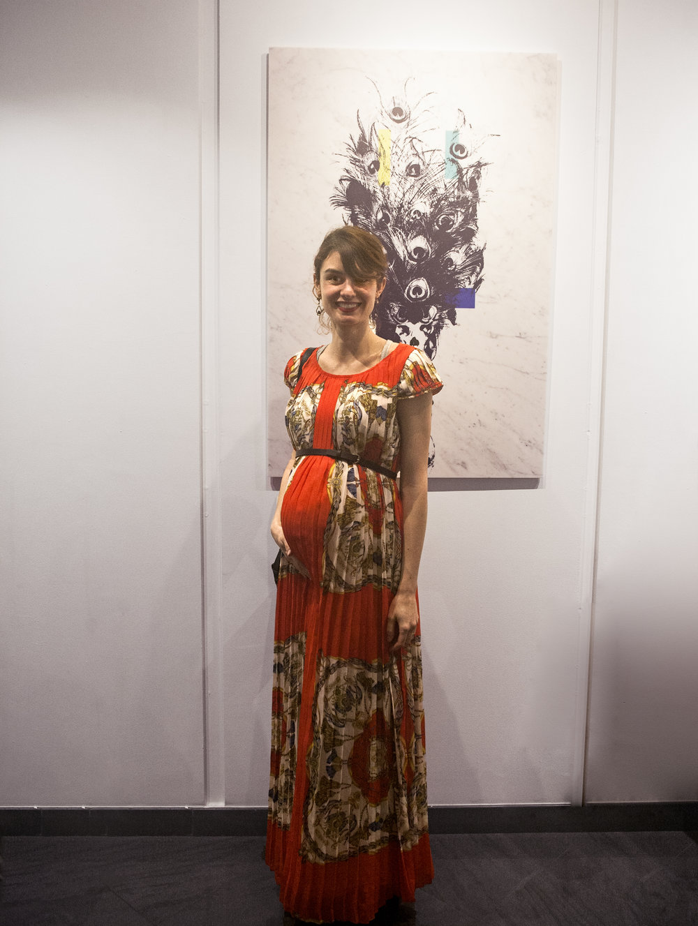 The artist Julia A. Etedi at the opening of her exhibition on the 8th of March at the Gallery Taglialatella.