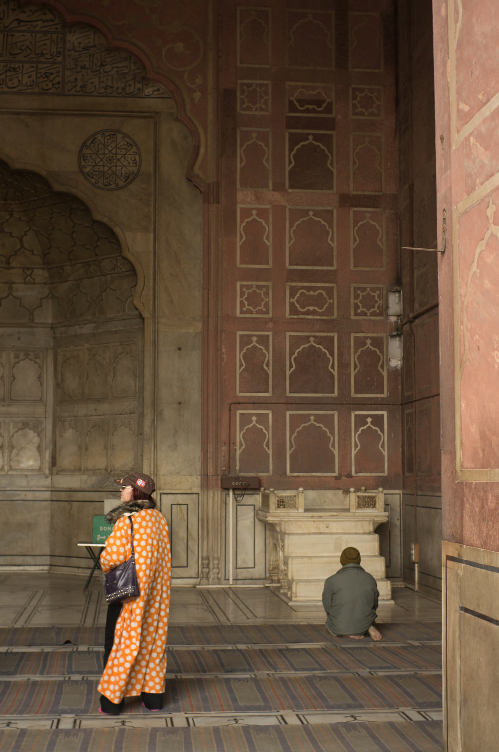 December 2011, Masjid-i Jahān-Numā (Jama Masjid), Dehli, India. The fur collar and hot pink socks make the ensemble.
