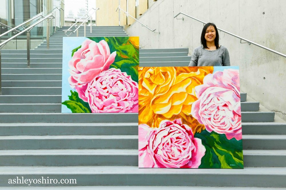 ashley_oshiro_calgary_artist_with_two_flower_paintings.jpg