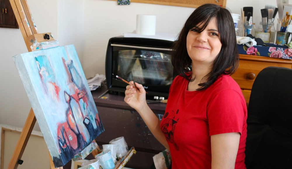 jasmine farrow in her art studio painting