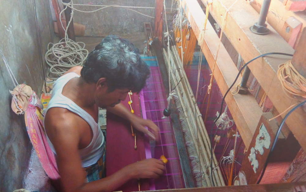 Image on top (from right to left) : A handloom saree in progress; punch card attached to the hand-loom; punch-card attached to a power-loom; a weaver using a power-loom.  Image above : a weaver at his studio weaving a saree.