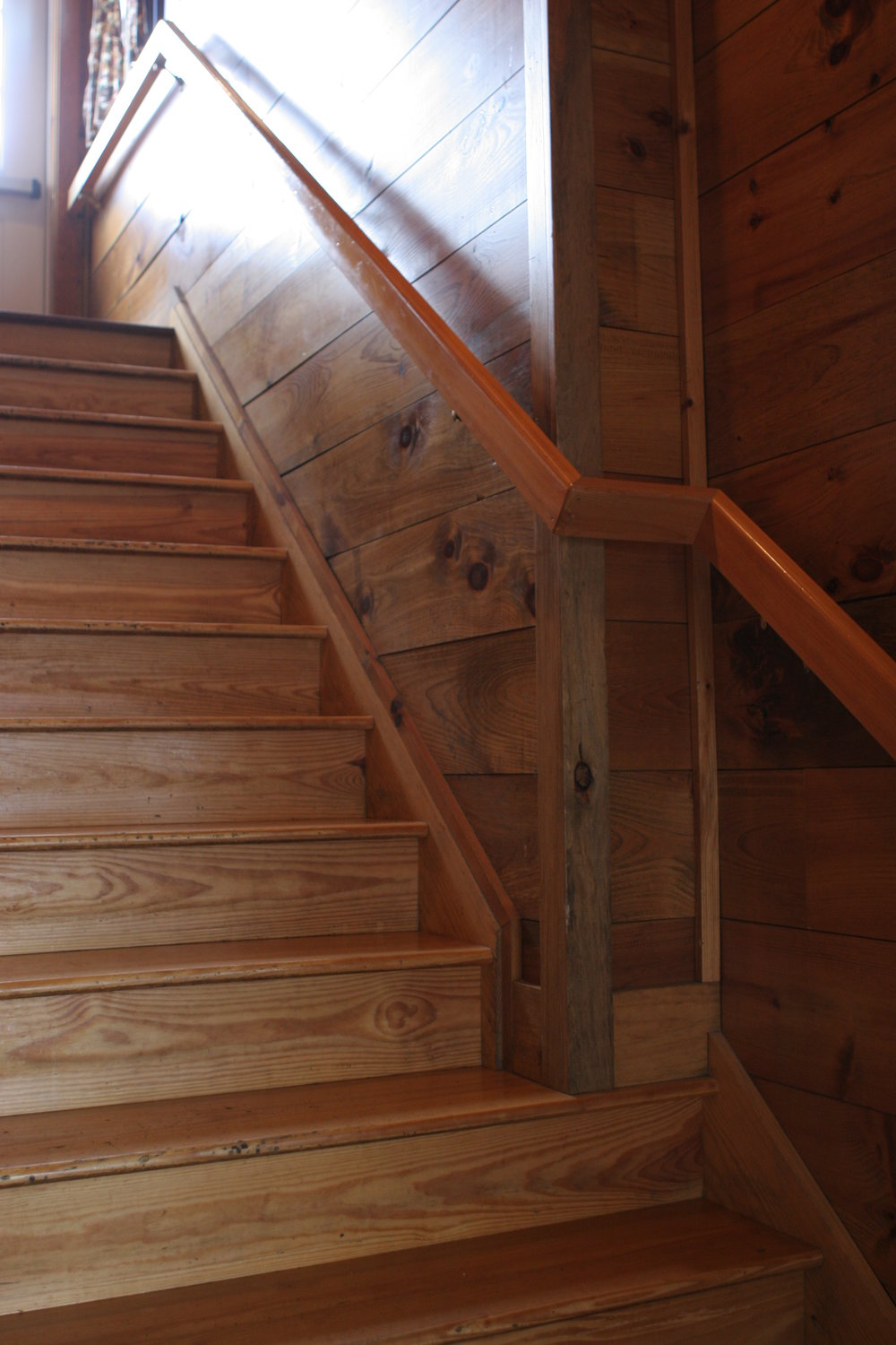 Pine stair treads, paneling and handrails at the Town Tavern.JPG