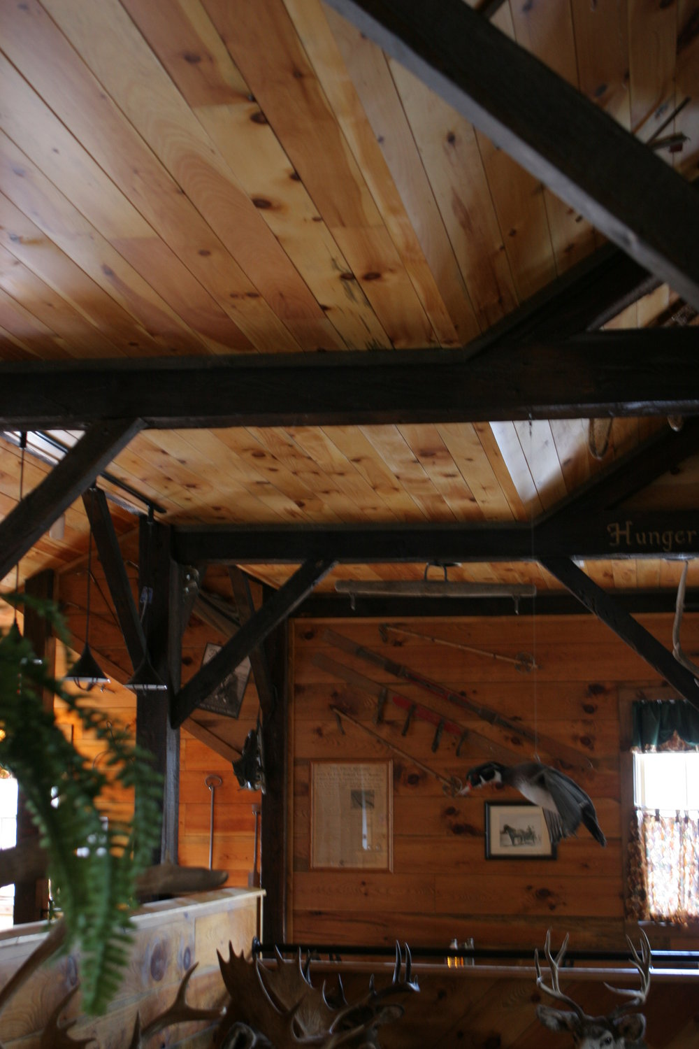 Exposed beams and pine tongue and goove at The Town Tavern.JPG