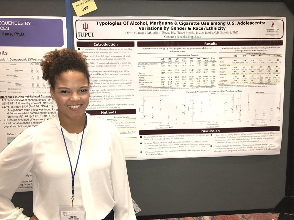 Devin Banks and her poster at RSA.
