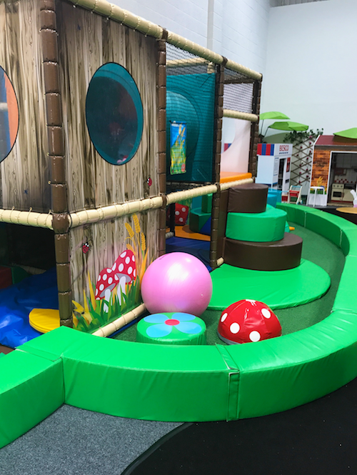 The tots softplay area has different levels and textures for sensory play.