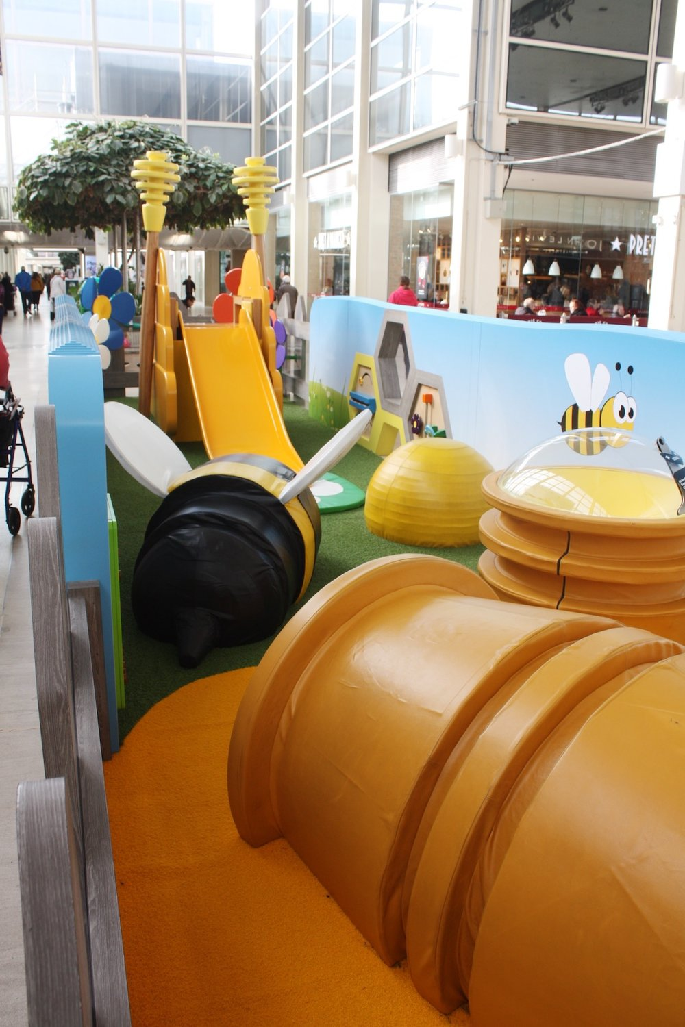 Children can climb on the giant bee and crawl into the honey pot tunnel.