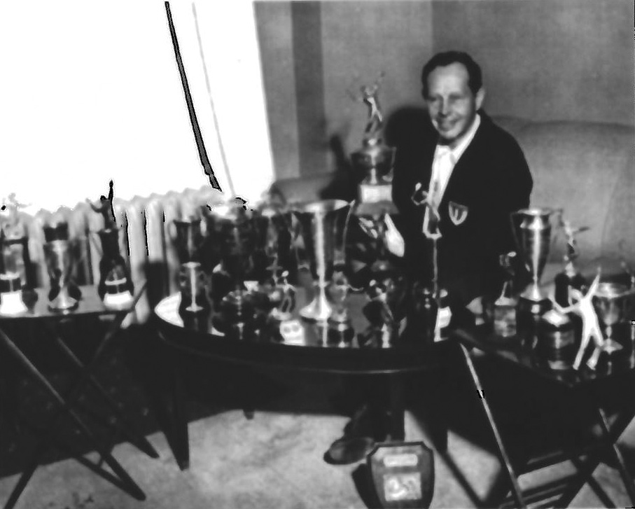 Karl Hodge displaying national senior championship trophies and other awards. (From the Hodge Family)