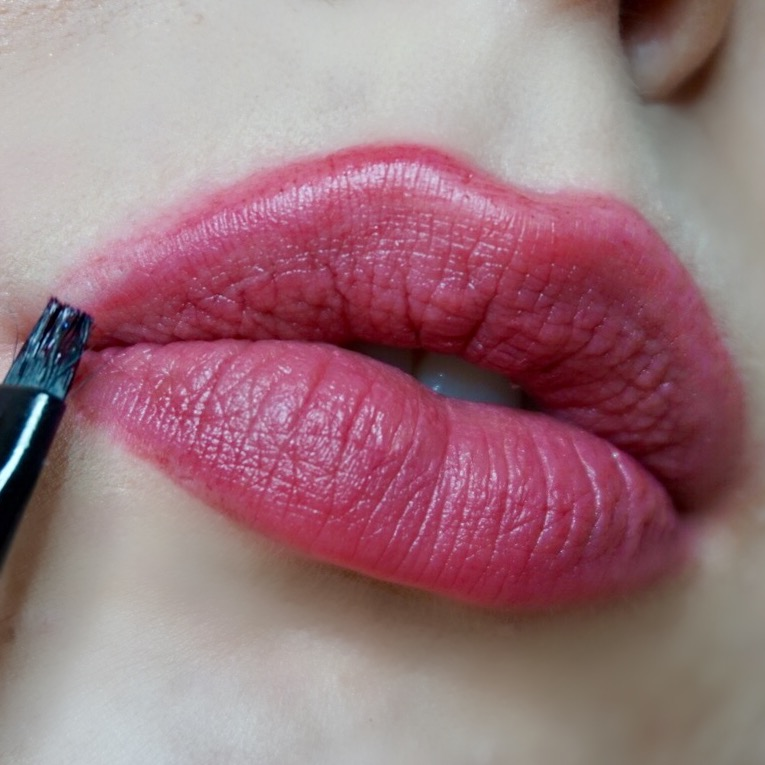 Applying with a small ELF angle brush, 'Bruise' Sheer Vice lipstick by Urban Decay Cosmetics