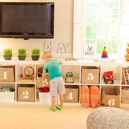 TIP :  Purchase Billy bookcases, lay on their sides, or use appropriate size according to space and placement.