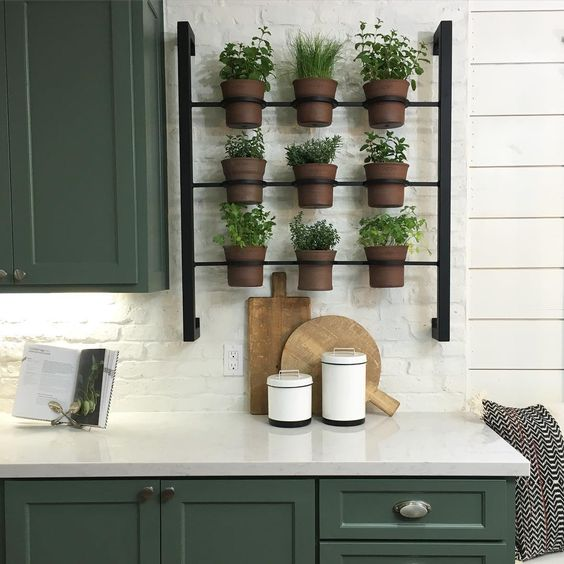 I love this herb garden pot rack Joanna Gaines designed!