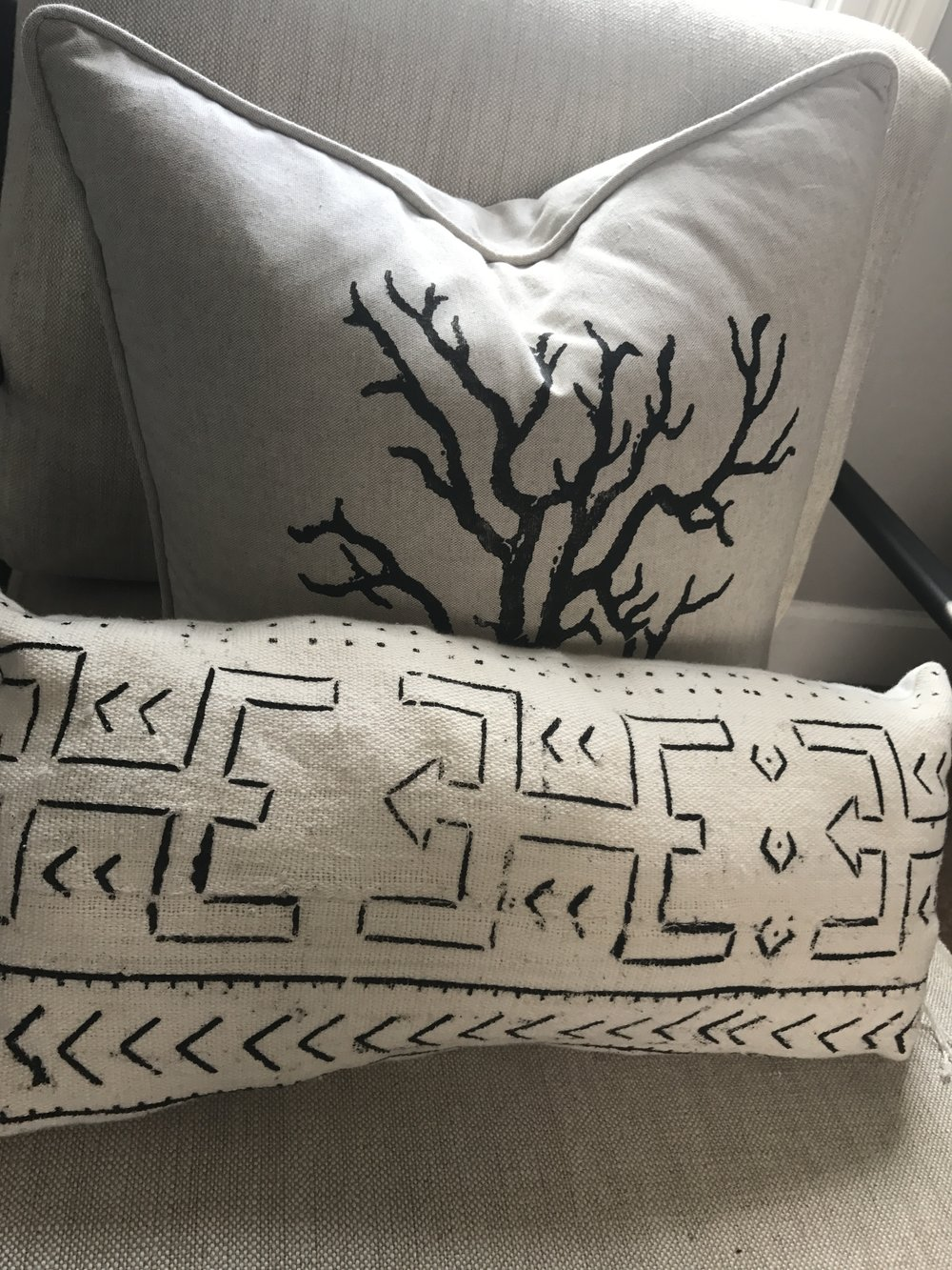 african mudcloth pillow and black and white coral pillow