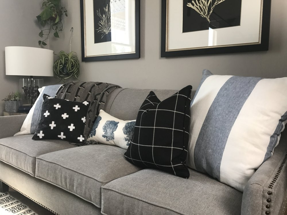 grey sofa black and white pillows