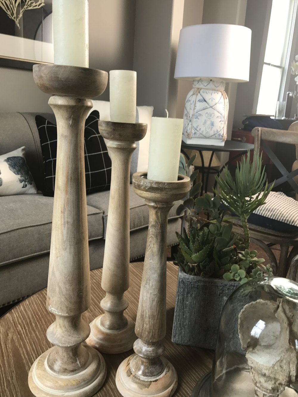 Don't be afraid to add height to your coffee table and follow with grouping like items in groups of three.