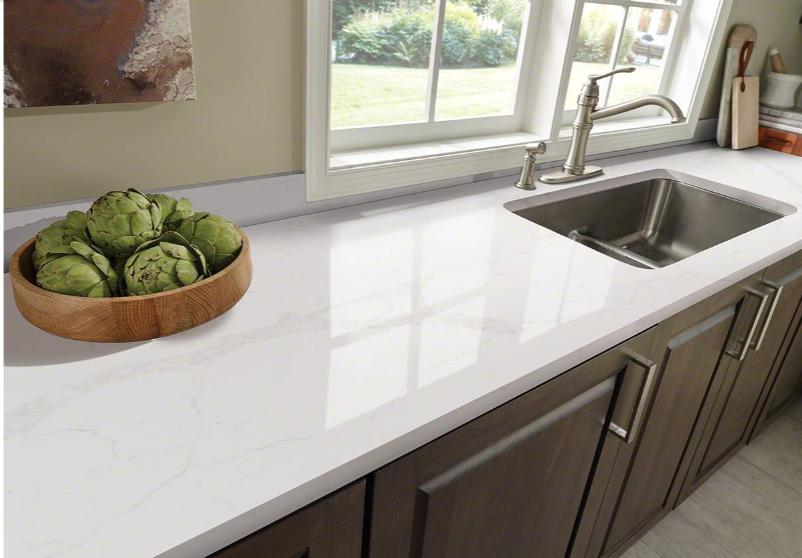carrara marble quartz countertop in kitchen.png