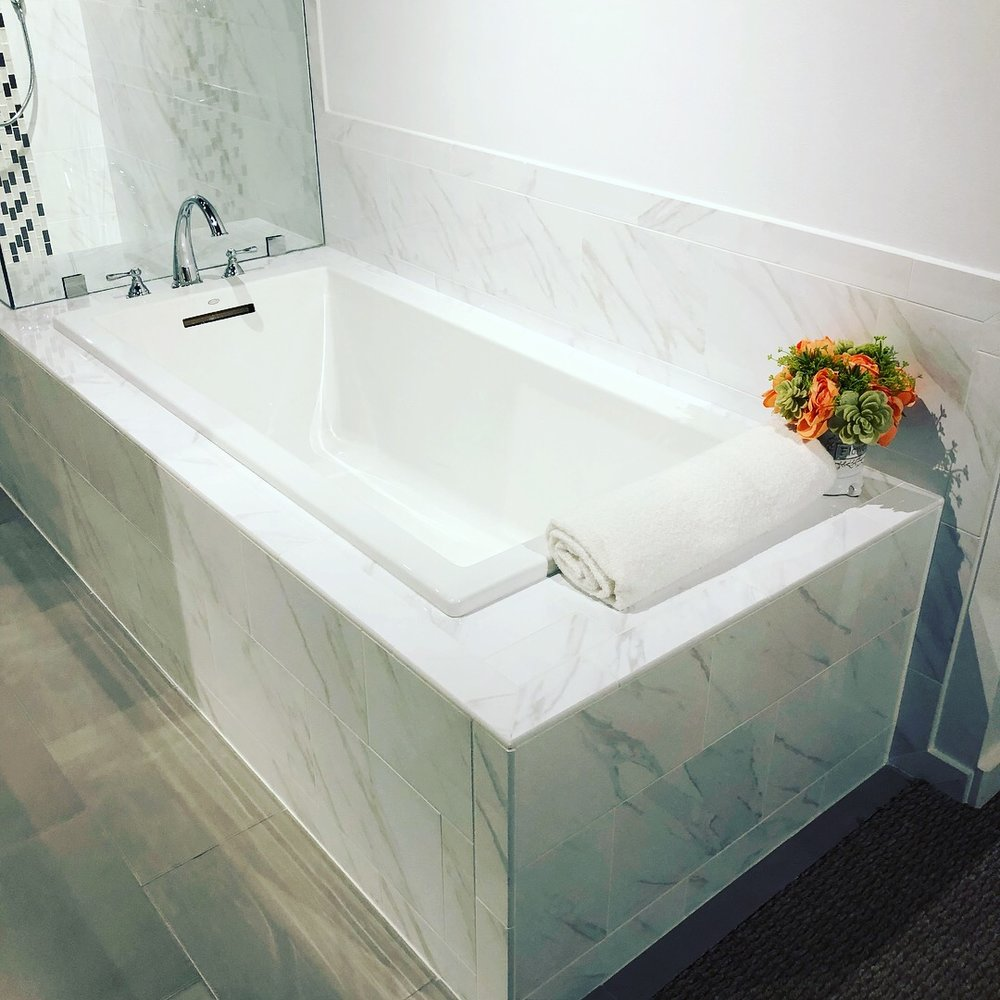 Team member Kim, bathroom remodel expert, installers Reborn Cabinets
