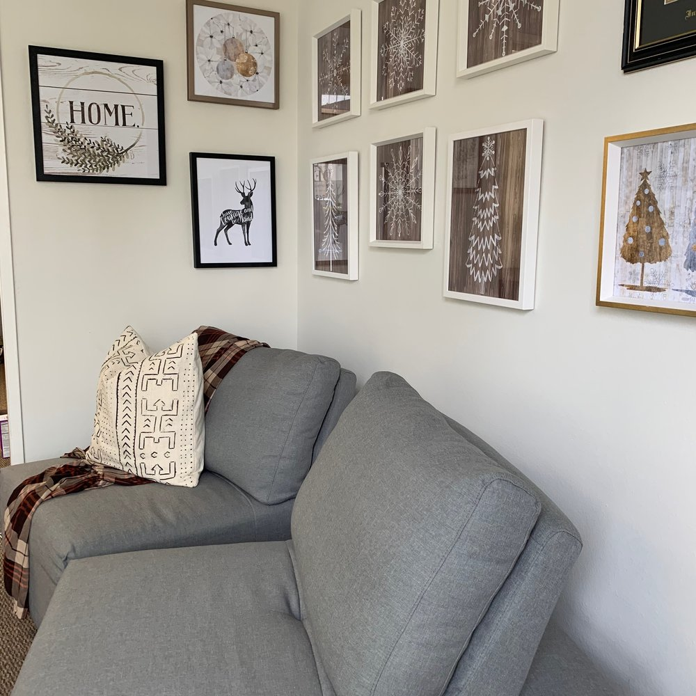 A corner of my boutique. White Tiger House Boutique. Earth tones in throw and wall decor. All holiday art is on sale! 50%!!