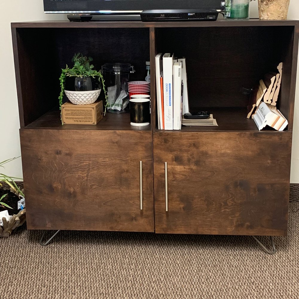 This section of my office is lesser wood, so growing plants and wood cabinet is a correct placement of aspects.