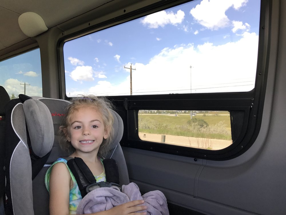 RV windows with screens to allow some circulation in the van. The great big windows for sight seeing are covered with a limo grade tint so that you can't see on the inside.