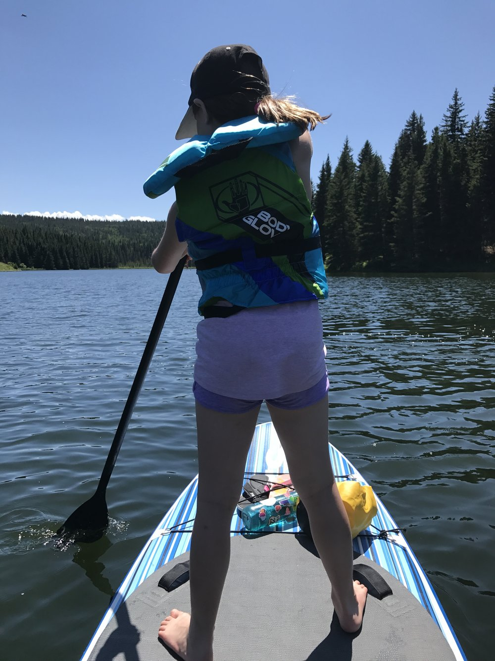 Sophie rocking the SUP at Spruce Coulee, Cypress Hills Provincial Park.