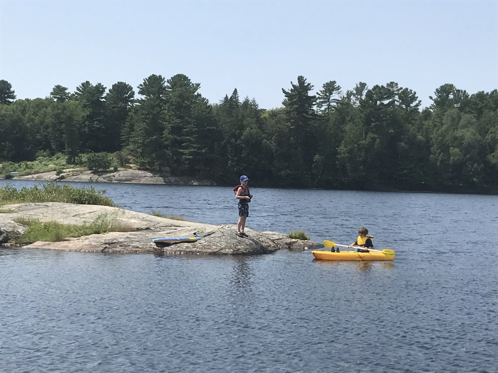 Noah, letting Ben try out his kayak.
