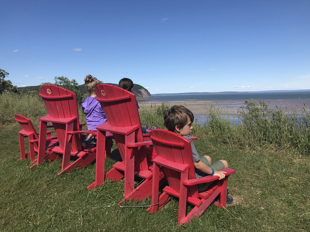 Red #sharethechair overlooking the Bay of Fundy at Fundy National Park.