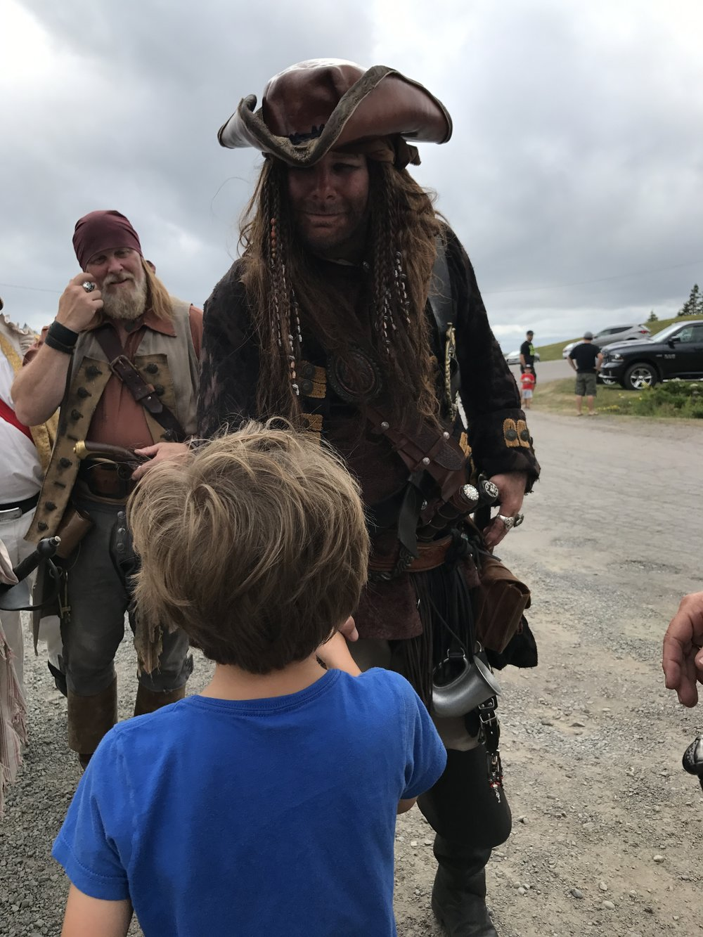 Ben shakes hands with the pirates...hoping to get on their good side. Though he did volunteer to get tossed overboard.