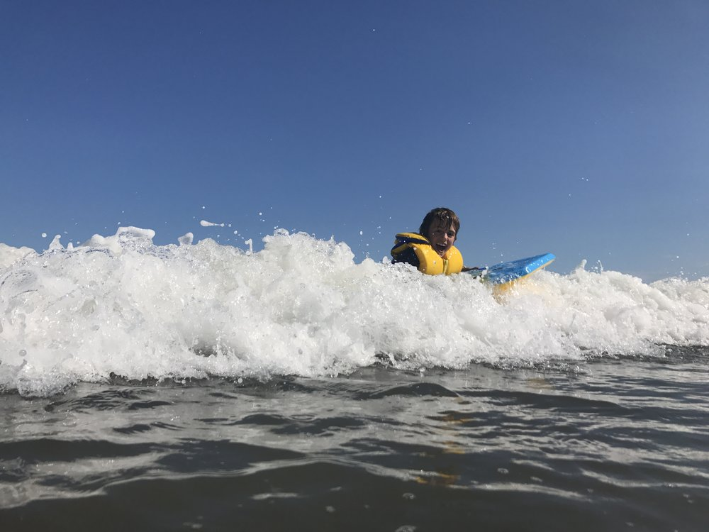 Ben catching the waves at Pondville Beach, Isle Madame.