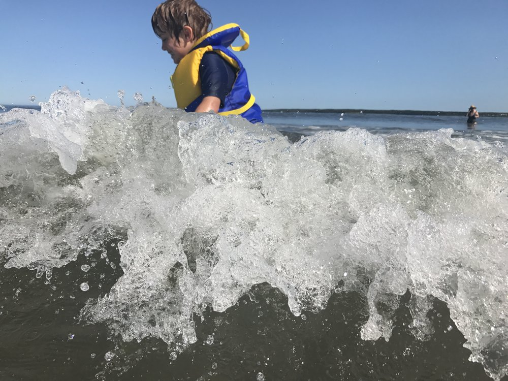 He can't get enough of the ocean fun.