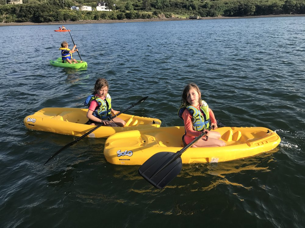 Kayaking in the Arichat harbour with our fun cousins Mia and Lily.