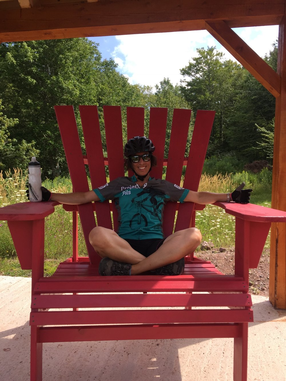 Resting in the massive red chairs at Keppoch after a fun pedal around their park.