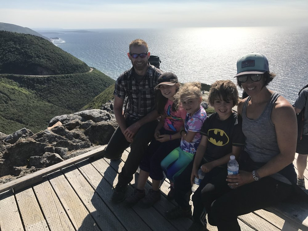 A stranger volunteered to take a family photo of us. A lovely day for a family hike!