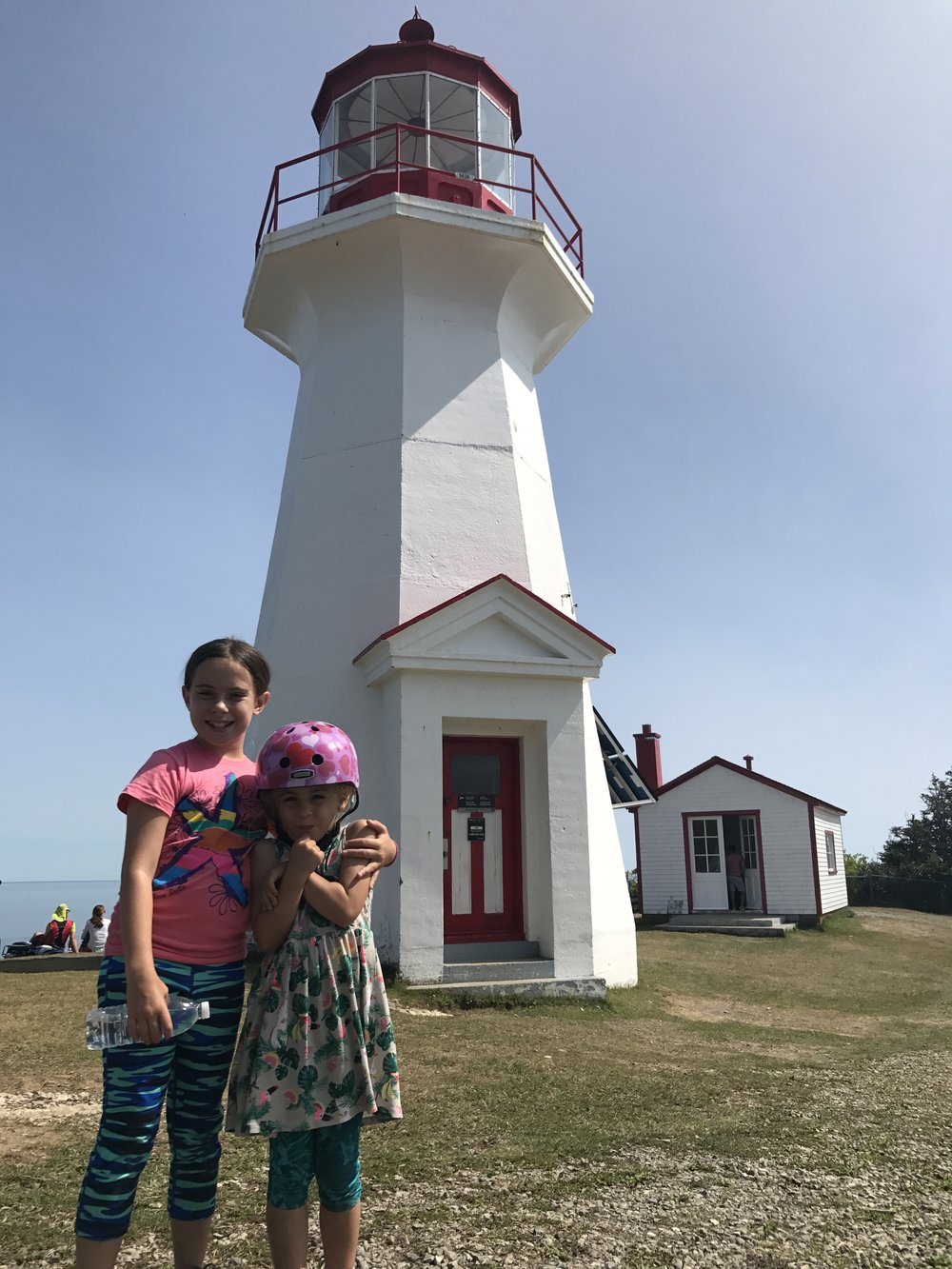 Sophie and Ellie steal a moment near the Cap-Gaspé lighthouse.