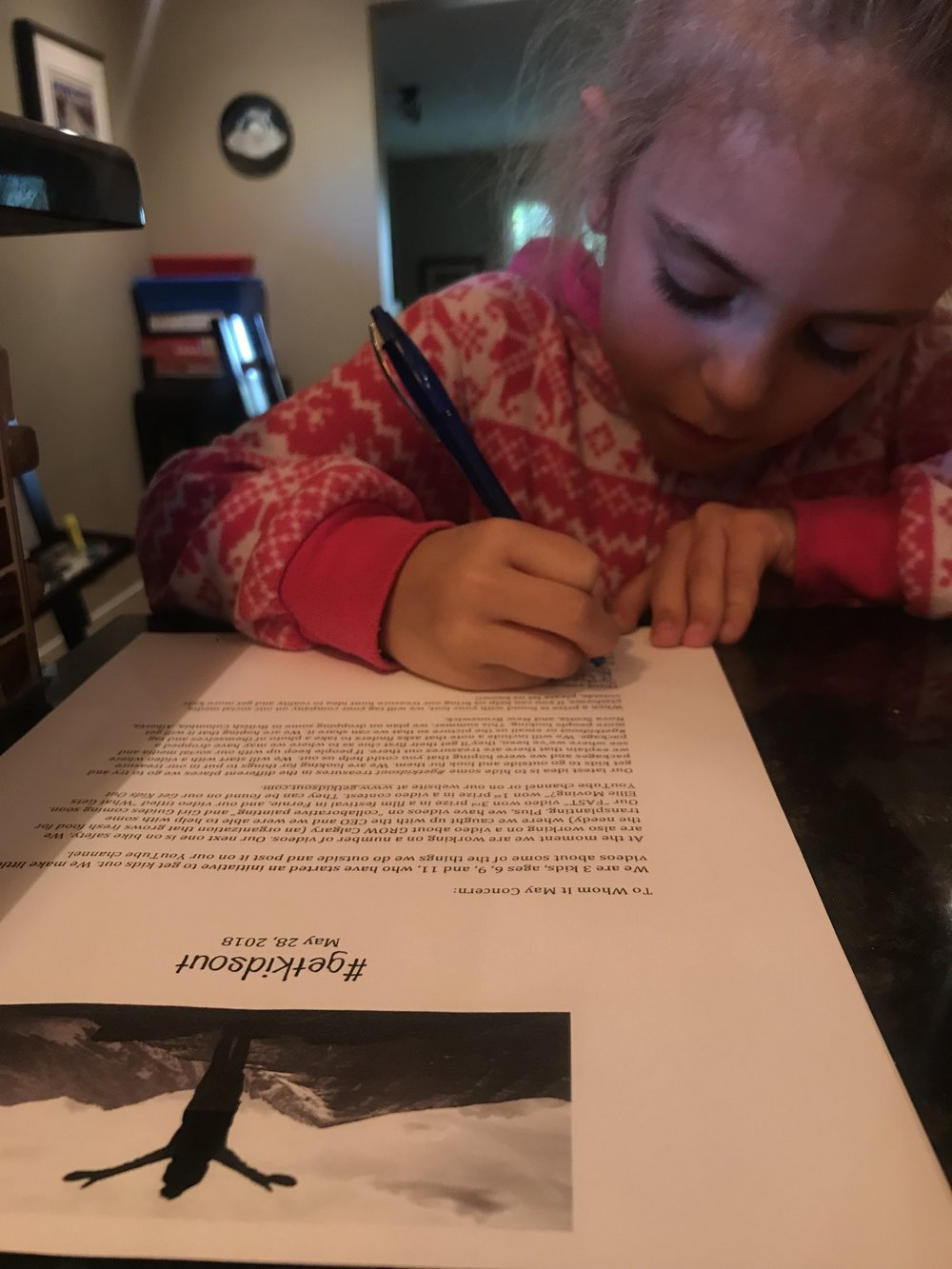 Ellie signs letters for businesses Post