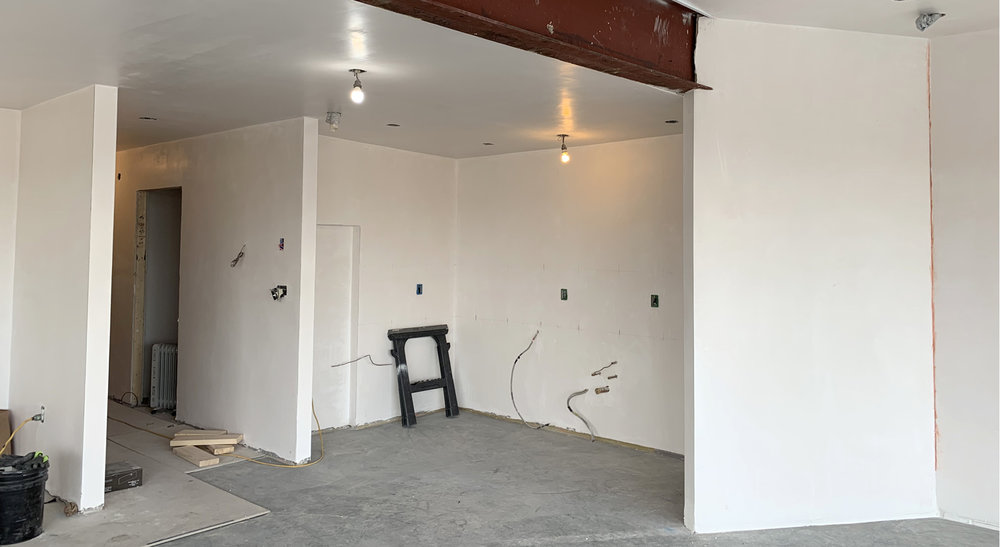 Future kitchen area and hall to restrooms