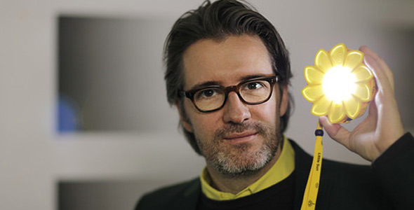 Olafur Eliasson with his Little Sun solar powered lamp