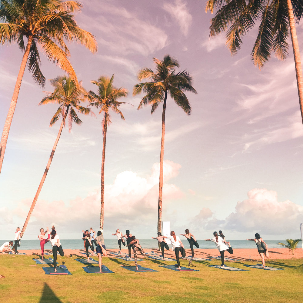 Early morning yoga by the beach