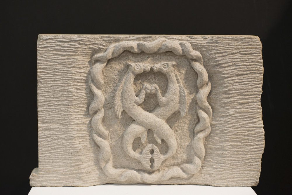Intertwined dragons stone carving by Sidney Bolam of Bohemian Hobbit Studio