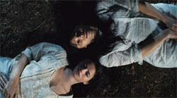2 women lying on the ground together