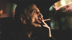 harry dean stanton smoking a cigarette