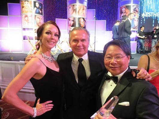 "Dr. Lee, WINNER of The Aesthetics Award 2015, with Plastic Surgeon Andrew Ordon of TV's ""The Doctors"" escorted by Showgirl, Model, & Friend Samantha Ostolaza."
