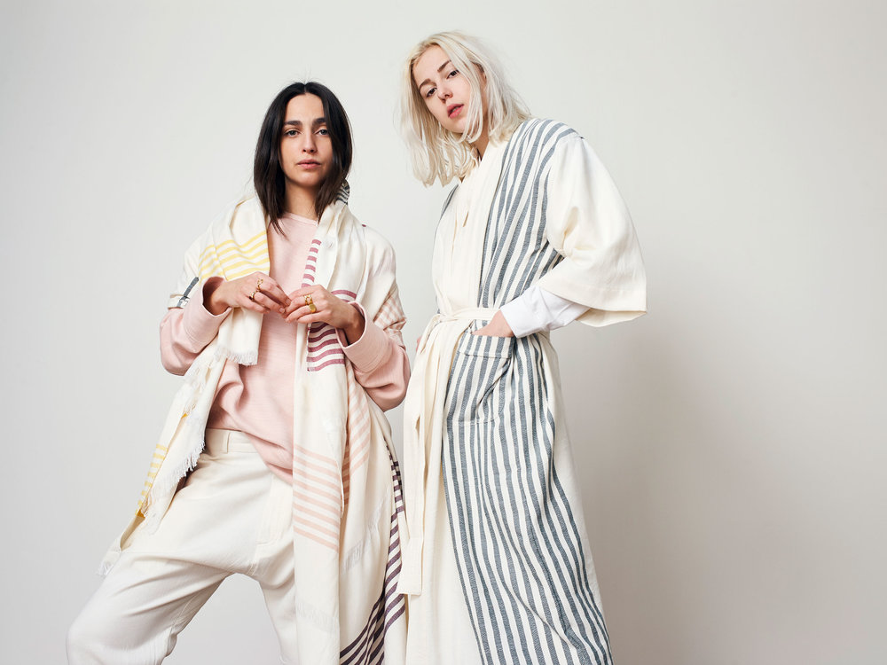 Jasmine (Left) wears a Sweatshirt and Drop Crotch Trousers and Beaudine (Right) wears a Robe from our Mariner Collection.