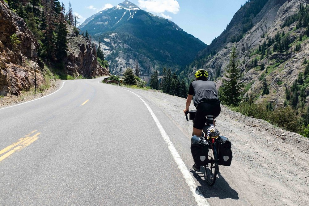Ben just CRUISING up Red Mountain Pass. Consistent grades around 6% kept things fairly low key. But you can expect to take around 2 hours to make it to the top if you're on a fully loaded bike.
