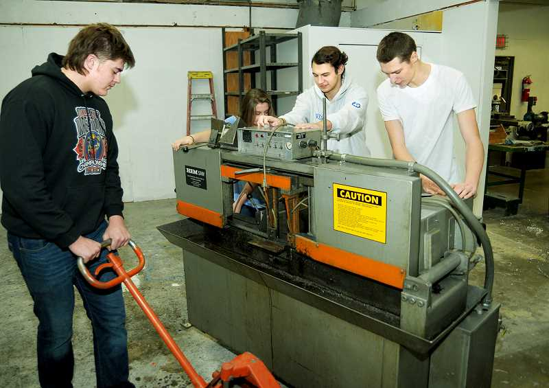 Students setting up Tiger Manufacturing's first machine.