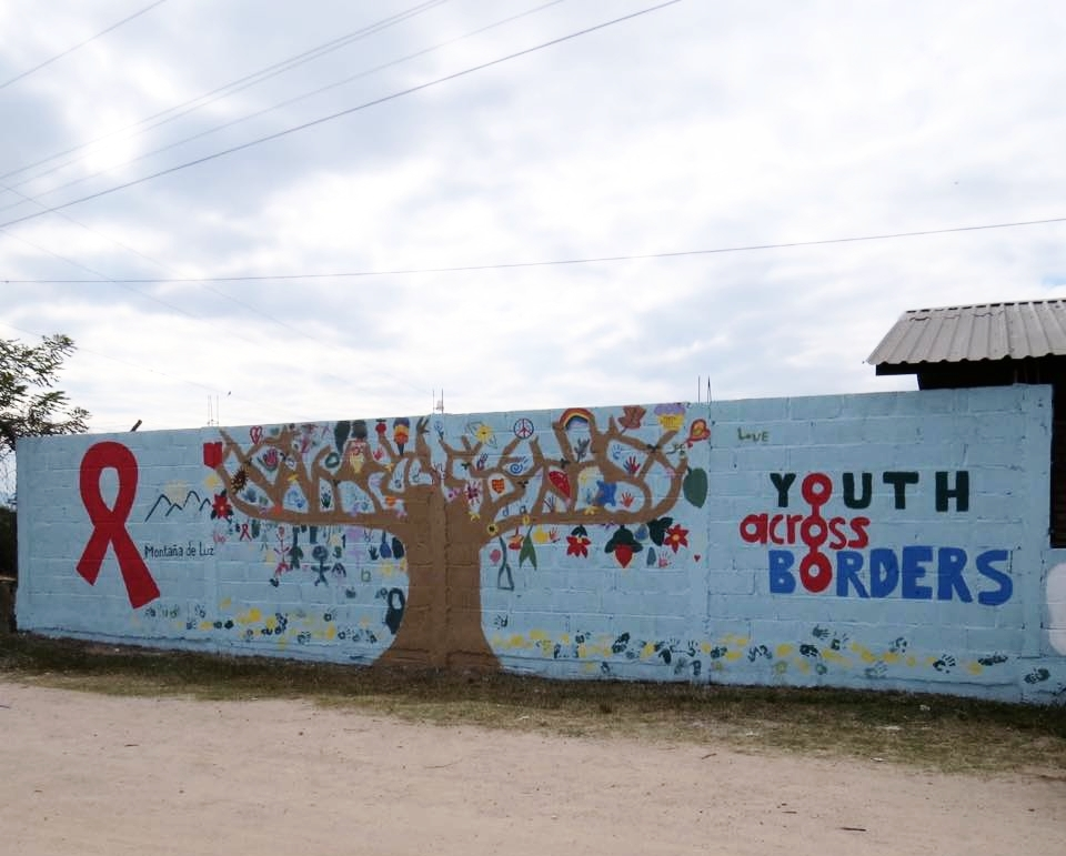 Our service team and youth from the group home at Montana de Luz transformed a wall covered with graffiti to one with words and images of inclusion. 3 years later the wall is still being respected and has not been destroyed.