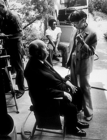 Edith Head working with Alfred Hitchcock at the Universal lot